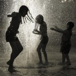 Children playing in the Rain <3
